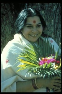 shri-mataji-white-with-flowers